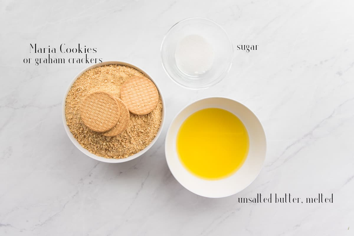 Ingredients to make the Maria cookie crust: Maria cookies, sugar, melted unsalted butter