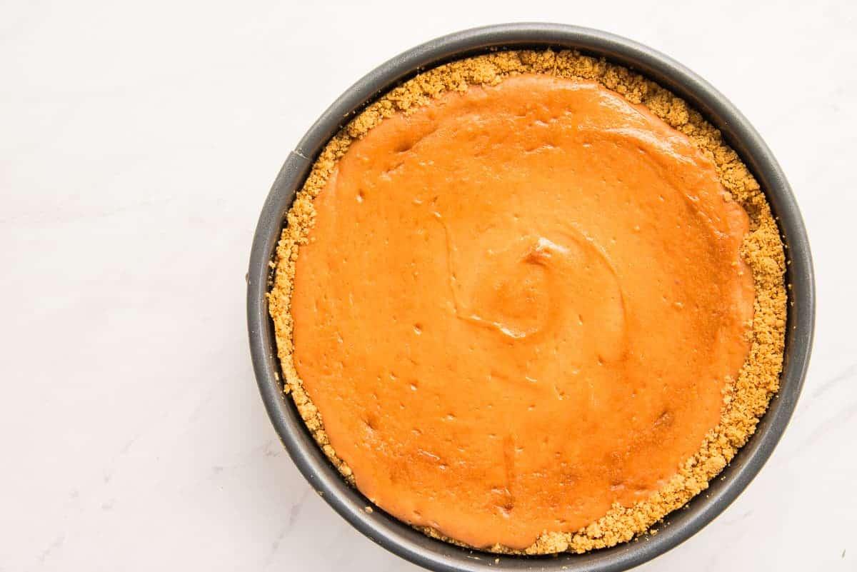 The baked Pastelillo de Guayaba Cheesecake in a black springform pan