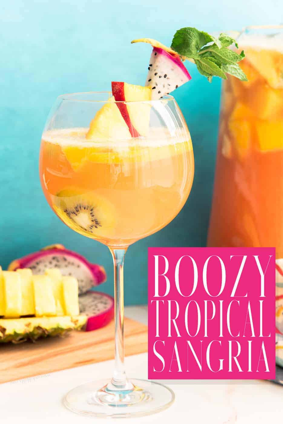 Tropical sangrias take your wine cocktail to the islands. Made with dry white wine and a mix of liqueurs, this drink will keep your guests happy and coming back for more. Recipe with swaps and subs are included. This is the ultimate party drink. #sangria #whitesangria #tropicalfruitsangria #tropicalsangria #boozysangria #whitewinedrink #cocktails #rum #passoa #peachschnapps #cointreau #moscato #guavanectar #recetadesangria #PuertoRicanrecipes via @ediblesense