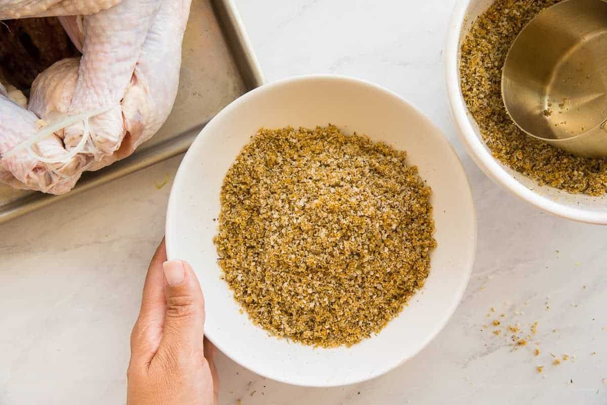 The spice mixture in a white ceramic mixing bowl