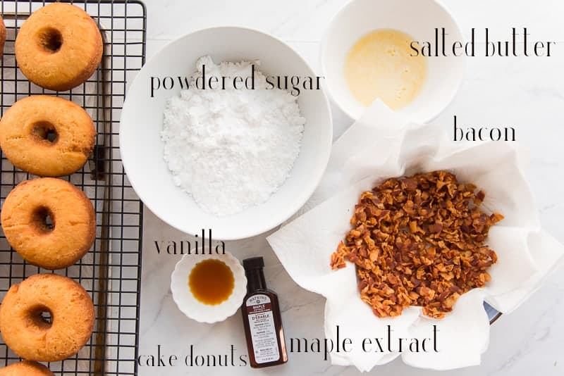 Ingredients to make Maple Bacon Cake Donuts: cake donuts, powdered sugar, salted butter, bacon, maple extract, and vanilla extract