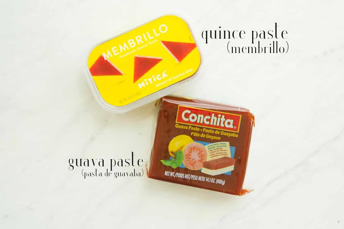Quince paste (membrillo) and guava paste on a white surface.
