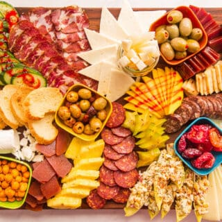 Preview image of Mexican Charcuterie Board on a wooden cutting board.