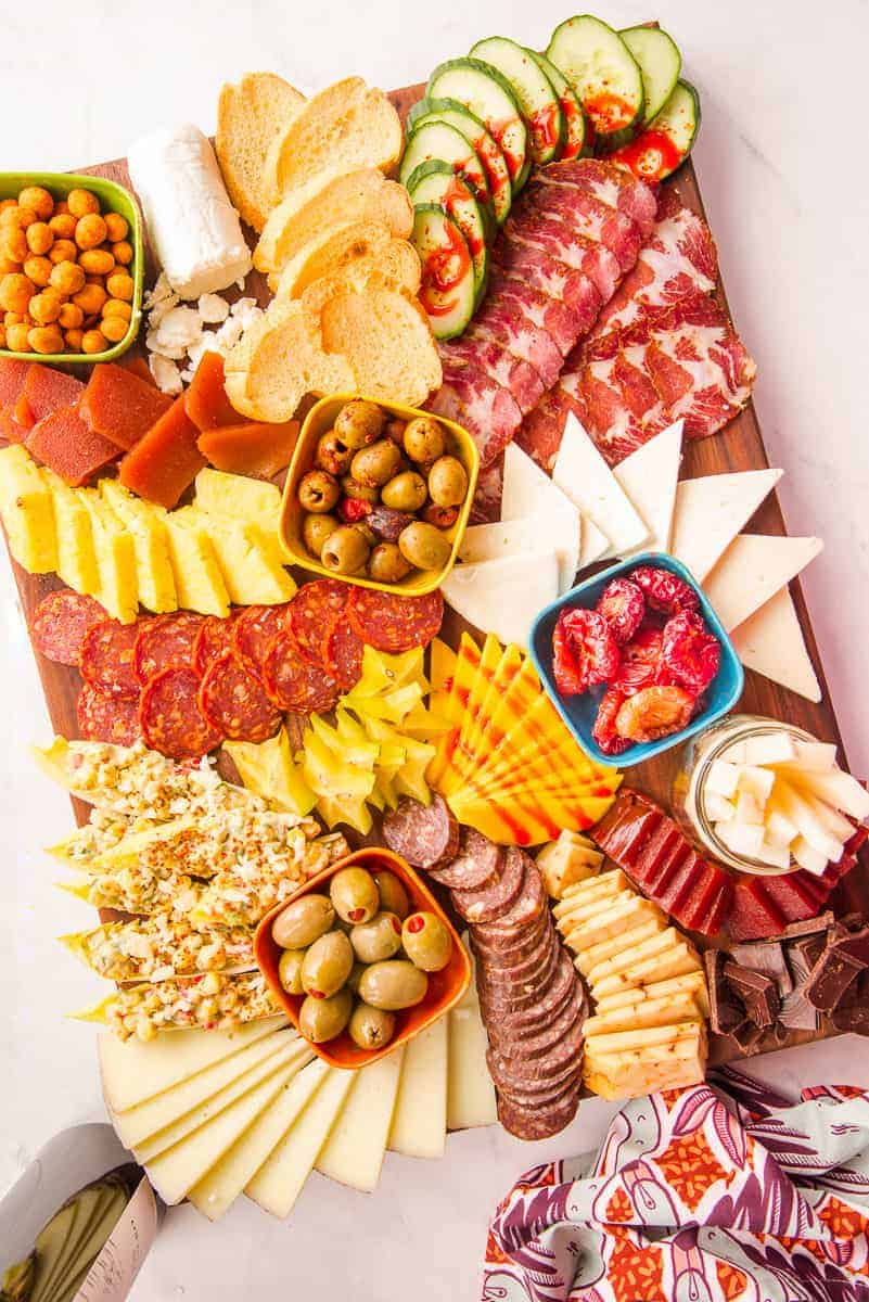 Lead image of Mexican-Inspired Charcuterie Board on a wooden surface.