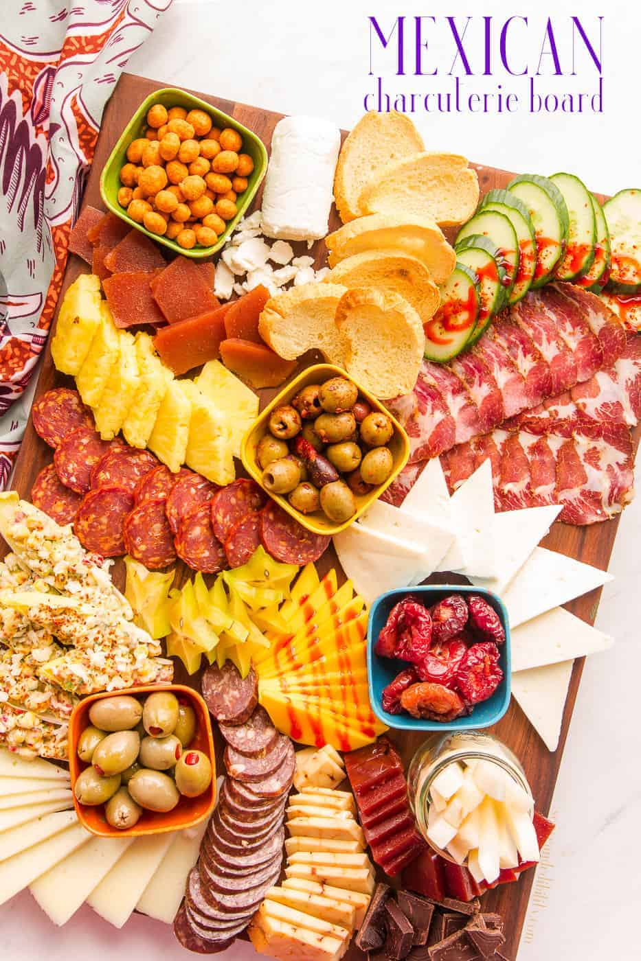 Make your next party unique with this Mexican-Inspired Charcuterie Board. Forget the same old meat and cheese board, this head-turner is loaded with cured meats popular in Mexican cuisine. Pair them with creamy and tangy cheeses and condiments lifted straight from antojitos shops and your next fiesta will be the one people rave about. #antojitos #charcuterieboard #meatandcheeseboard #chorizo #salami #panela #manchego #watergrows #texascorn #NRCSTexas #sponsored via @ediblesense
