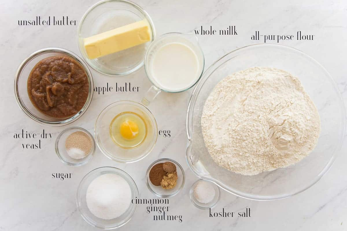 Ingredients to make the Apple Cinnamon Rolls: unsalted butter, whole milk, all-purpose flour, kosher salt, cinnamon, ginger, nutmeg, egg, apple butter, active-dry yeast, and sugar