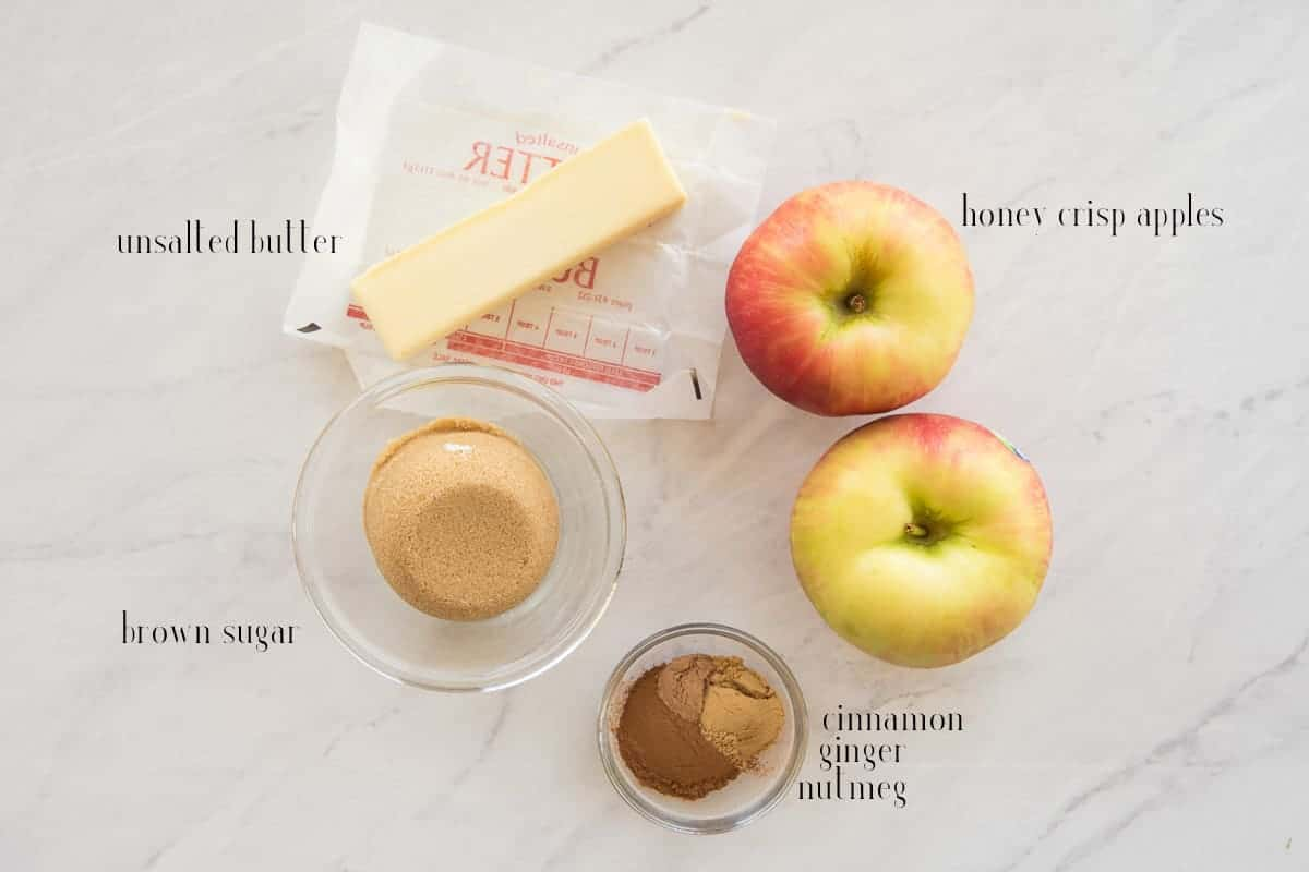 Ingredients to make the Apple-Cinnamon filling for the apple cinnamon rolls: unsalted butter, honey crisp apples, cinnamon, ginger, nutmeg, and brown sugar.